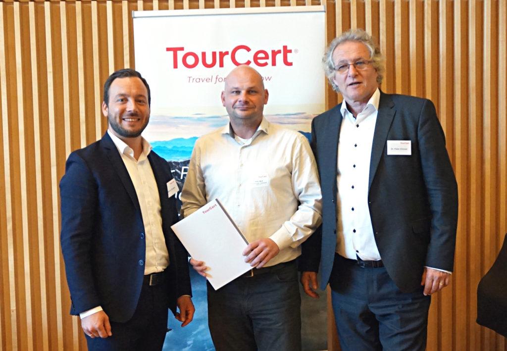 Marco Giraldo, Sven Wolf und Dr. Peter Zimmer
